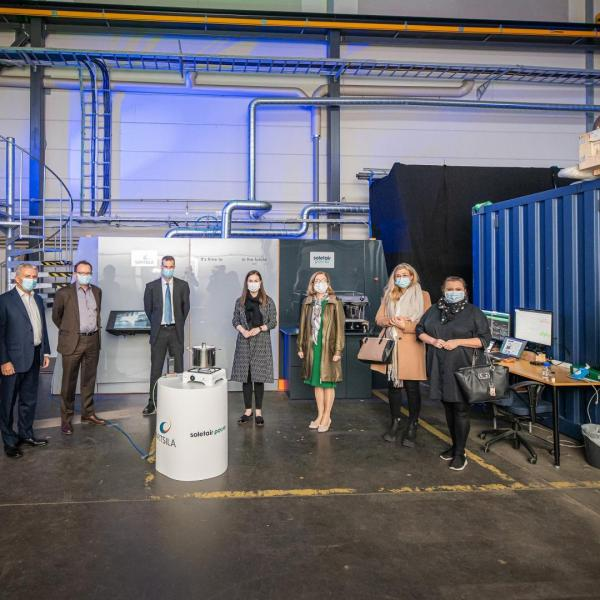 Soletair Power has delivered a Power-to-X unit to Wärtsilä Corporation for the World Expo in Dubai. Pictured is also Finnish Prime Minister Sanna Marin, who visited the factory (4th on the right).